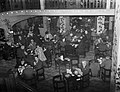 Diners in a busy restaurant at Aldwych in London during spring 1941. D2956.jpg