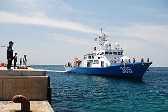 Liancourt Rocks - A South Korean Police boat approaches the dock on Liancourt Rocks' East Islet.