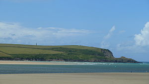 Doom Bar - The Doom Bar and Stepper Point from Daymer Bay; the dip caused by rock being removed from Stepper Point is clearly visible.