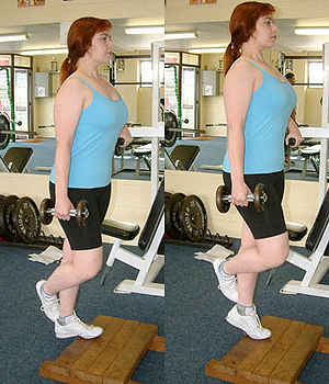 Calf raises - Standing unilateral calf raise with a dumbbell