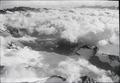 ETH-BIB-Blüemlisalp, Gletscher mit Wolken, Schlossstock, Dammakette, Finsteraarhorn v. N. O. aus 3300 m-Inlandflüge-LBS MH01-003947.tif