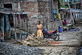 Early morning chores on a cul-de sac in Dewas (11484432475).jpg
