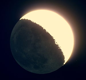 Planetshine - Earthshine reflecting off the Moon, as seen through a telescope. The bright region is directly illuminated by the Sun, while the rest of the Moon is illuminated by light reflected off the Earth.