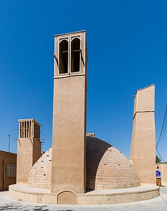 Windcatcher - An ab anbar (water reservoir) with double domes and windcatchers (openings near the top of the towers) in the central desert city of Yazd, Iran