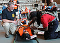 Emergency services personnel triage a mock victim during exercise Golden Eagle III at Stewart Air National Guard Base, Newburgh, N.Y., June 1, 2013 130601-Z-VX101-035.jpg