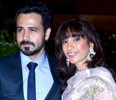Emraan Hashmi and Parveen Shahani looks away from the camera