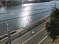 Emukaegawa River and Japan National Route 204 from train of Matsuura Railway.jpg