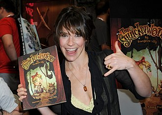 Evangeline Lilly - Lilly holding a copy of her children's book, The Squickerwonkers, at the 2013 San Diego Comic Con