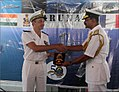 Exchange of crest between Rear Admiral Didier Piaton and Rear Admiral MA Hampiholi at Varuna 2018 (2).jpg