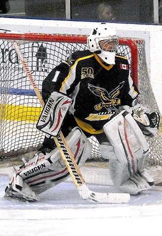 Southern Ontario Junior Hockey League - Exeter Hawks goalie readies for a shot in Dorchester, Ontario during the 2013-14 season.