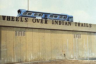 Stencil graffiti - John Fekner Wheels Over Indian Trails 1979-1990. Pulaski Bridge near the Queens Midtown Tunnel Spray paint on concrete. Long Island City, NY.