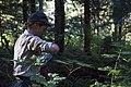Female Ranger opening Water Bottle in Forest, Mt Baker Snoqualmie National Forest (31265646734).jpg