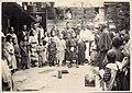 Festival in Japan - Man with a Crowd (1914 by Elstner Hilton).jpg
