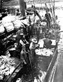 Fishermen cleaning codfish on the deck of the power schooner Union Jack, Alaska, 1912 (COBB 205).jpeg