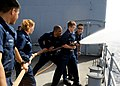 Flickr - Official U.S. Navy Imagery - Sailors practice handling a charged fire hose aboard USS Leyte Gulf.jpg