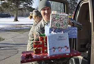 Sgt. Joshua Seil unloads gifts at the North Da...
