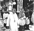 Frère Roger (center) and Franz Kardinal König (right) leaving Vienna's St. Stephen's Cathedral after oecumenical church service.jpg