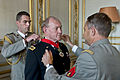 French Army Gen. Pierre de Villiers, foreground, chief of defense staff, helps place the French Legion of Honor medal on U.S. Army Gen. Martin E. Dempsey, center, chairman of the Joint Chiefs of Staff, in Paris ID16838.jpg