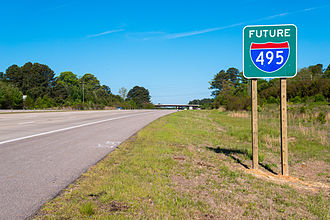 "Interstate 87 (North Carolina) - ""Future I-495"" sign along US 64/US 264, near Knightdale. Signs like this were later replaced by ""Future I-87"" signs."
