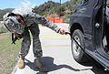 GI inspects the underside of a vehicle at Guantanamo.JPG