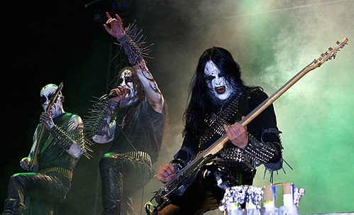 Members of Gorgoroth wearing typical black metal gear such as corpse paint, spikes and bullet belts. The band was formed by guitarist Infernus to express his Satanist beliefs. Gorgoroth I.jpg