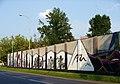 """Graffiti """"Muzyka Wczoraj i Dziś"""" na ścianie budynku przy ulicy Północnej 43. - panoramio (1).jpg"""