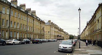 Bath stone - Great Pulteney Street, Bath, looking West towards Pulteney Bridge.  The style and Bath stone used are typical of much of the city.