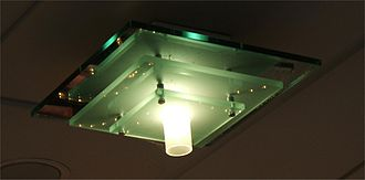 Float glass - A float glass light fitting. Ordinary float glass is green in thicker sheets due to Fe2+ impurities.
