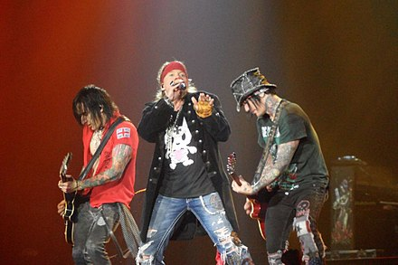 Guns N' Roses performing at Nottingham Arena, Nottingham, UK, in May 2012. From left to right, Richard Fortus, Axl Rose, DJ Ashba. Guns n Roses Nottingham 2012.JPG