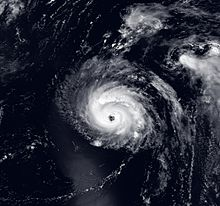 A satellite image of a strong hurricane, with the eye visible near the center of the picture