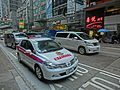HK 中環 Central 皇后大道中 Queen's Road Police car white automatic vehicle sidewalk carpark Dec-2013.JPG