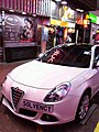 HK Mongkok Shantung Street night white car Solvency Oct-2012.JPG