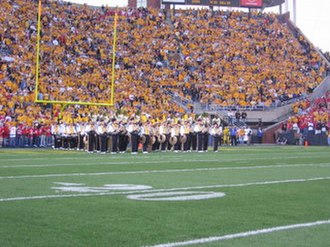 Hawkeye Marching Band - The drumline and sousaphone sections prepare for the pregame show.