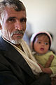 Hussein and his father (15047108694).jpg