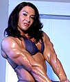 IFBB Pro Alina Popa flexing triceps.jpg