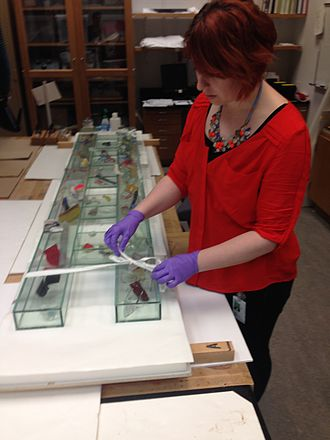 Objects conservator - Mallory Marty prepares an object to be moved  at the Indianapolis Museum of Art to prevent damage while in transit.