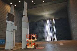 Ames Research Center - Inside 80 by 120 foot wind tunnel facing towards the intake. Aircraft or scaled models of them can be mounted on the three struts in the foreground which in this picture hold individual airplane wing portions.