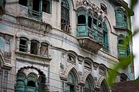 Intricate jharokhas still adorn the house.JPG