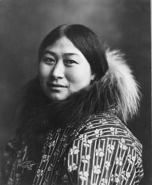 Photograph of an Alaska Native woman wearing a...