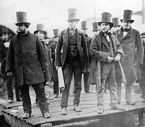 John Scott Russell -  John Scott Russell (builder), Henry Wakefield (Russell's assistant), Isambard Kingdom Brunel (designer) and Lord Derby at the launching of the Great Eastern.