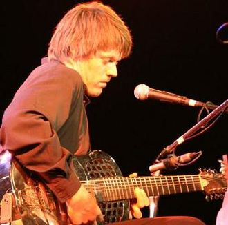Guitar - An 8-string baritone tricone resonator guitar.
