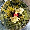 Jasmine tea in a glass (8658148091).jpg
