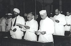 Jawaharlal Nehru and other members taking pledge during the midnight session of the Constituent Assembly of India held on 14 and 15 August 1947.