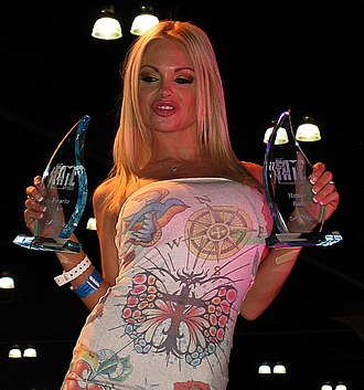 Fans of Adult Media and Entertainment Award - Jesse Jane holding two F.A.M.E. Awards in 2007