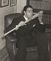 Joe DiMaggio salutes his bat.jpg