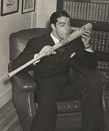 Joe DiMaggio salutes his bat