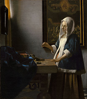 <i>Woman Holding a Balance</i> painting by Johannes Vermeer