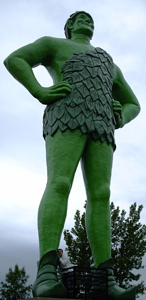 A statue of the Jolly Green Giant towers above...