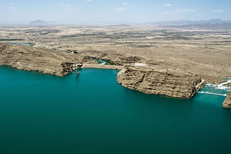 Kajaki Dam - A 2012 aerial photo showing a small portion of the reservoir along with the dam (left) and the spillway (right)