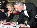 Katie Harman signs document.jpg